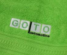 Vezenje logotipa GOTO na brisače