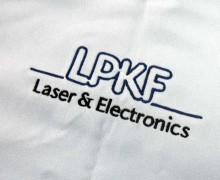 Vezenje logotipa LPKF na brisače