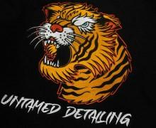 Vezenje logo tiger untamed detailing